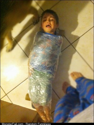 My nephew taped his little brother to my nieces skateboard
