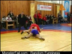 Wrestling referee pulling off a move