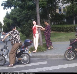 Old lady ties a sex doll to a tree to slow traffic down