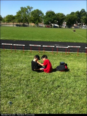 This is my little best friend pinning a ribbon on him after finding out my brother win any ribbons at the track meet