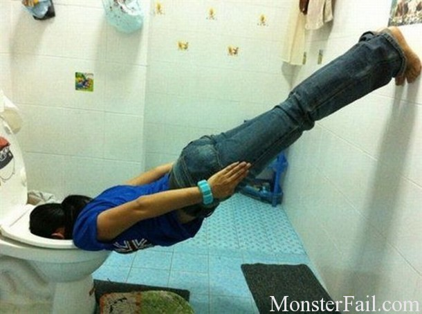 girls planks with face in toilet