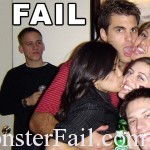 guy is left out of picture while his girlfriend hugs and kisses with a different group of guys and girls