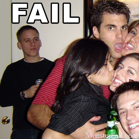Guy is left out of picture while his girlfriend participates in group hugging and kissing.