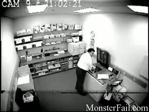 Employee tries to scan his ass on the scanner but ends up falling though it and gets caught on video tape.