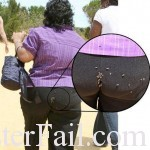 black woman has flies coovering her ass over her pants.