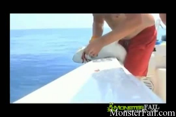 Baby great white shark gets revenge on fisherman.  Makes him squeal like a little bitch.