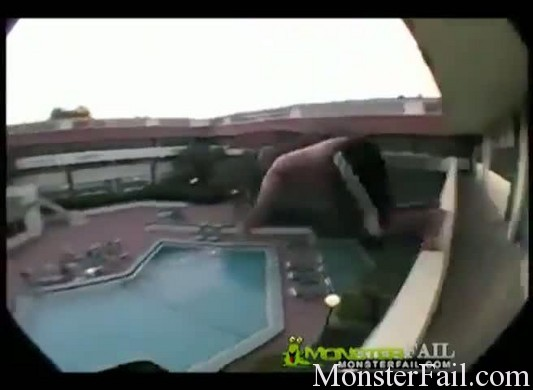 Idiot attempts the stupidest pool jump.