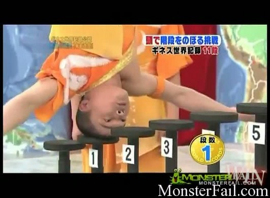 Man walks up stairs on his head.  Breaks world record.  WIN