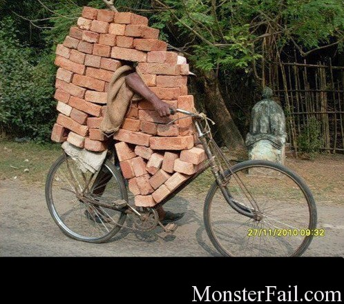carrying bricks on bicycle