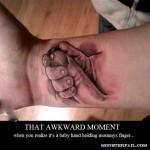 Holding mommys finger?