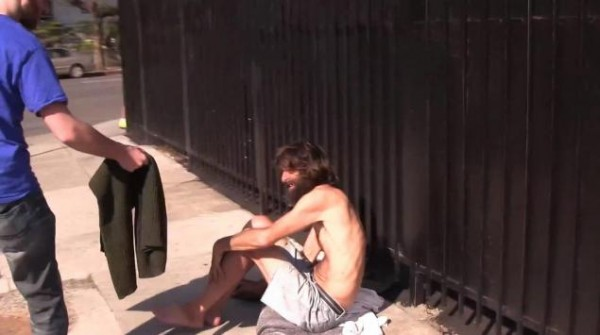 Man gives away free Abercrombie & Fitch clothes to homeless in attempt to ruin their 'pretty' image.